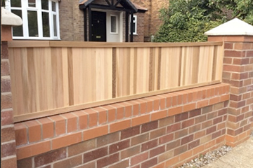 Brick and Timber Wall built by Landscape Zoolutions.