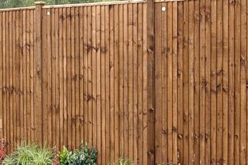 Vertical Slatted Garden Fence built by Landscape Zoolutions.